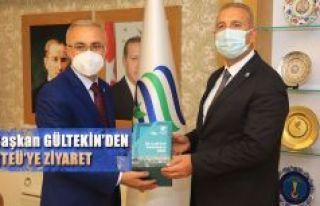 DOKAP Başkanı Hakan Gültekin, Rektör Karaman'ı...